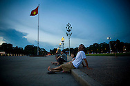 Locals relax on the sidewalk in front of Ho Chi Minh Mausoleum, Hanoi, Vietnam, Southeast Asia