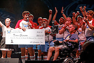 The 610 Stompers present a check for $25,610 to Team Gleason at Gleason Gras, benefiting The Gleason Family Trust, at Champions Square on September 6, 2013. (Photo Frank L Aymami III)