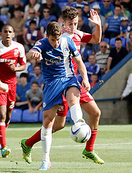 Peterborough United's Tommy Rowe in action with Swindon Town's Ryan Mason - Photo mandatory by-line: Joe Dent/JMP - Tel: Mobile: 07966 386802 03/08/2013 - SPORT - FOOTBALL -  London Road Stadium - Peterborough -  Peterborough United v Swindon Town - Sky Bet One