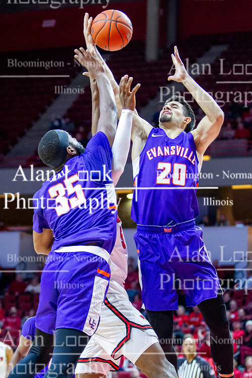 NORMAL, IL - January 29: John Hall and Sam Cunliffe battle Keith Fisher III for a rebound during a college basketball game between the ISU Redbirds and the University of Evansville Purple Aces on January 29 2020 at Redbird Arena in Normal, IL. (Photo by Alan Look)