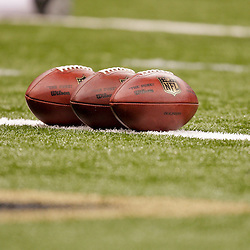 2009 September 03: Footballs on the field before a preseason game between the Miami Dolphins and the New Orleans Saints at the Louisiana Superdome in New Orleans, Louisiana.