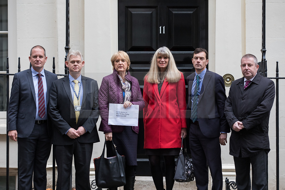© Licensed to London News Pictures. 14/11/2017. London, UK. Head teachers deliver a letter to The Chancellor of The Exchequer Philip Hammond, signed by 5,000 head teachers, demanding fairer funding for schools. Photo credit: Rob Pinney/LNP