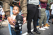 Girl with a stuffed Zulu doll she got at the Zulu parade on Mardi Gras day in New Orleans.