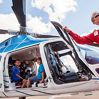 091413       Cable Hoover<br /> <br /> Sean Spolar, left, and Blaise Chavez check out the Tri-State Care Flight helicopter as it presented by flight paramedic Jim Ivy during the Preparedness and Public Safety Day at the Rio West Mall in Gallup Saturday.