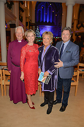 Left to right, the Rt.REV.SANDY MILLAR, JULIA SAMUEL, FLAPPY LANE FOX and ALAN TITCHMARSH at the charity Child Bereavement UK's 21st Anniversary Christmas Carol Concert held at Holy Trinity Brompton, London on 10th December 2015.