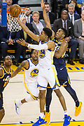 Golden State Warriors guard Patrick McCaw (0) takes the ball to the basket against the Utah Jazz at Oracle Arena in Oakland, Calif., on December 27, 2017. (Stan Olszewski/Special to S.F. Examiner)