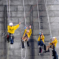 """Four protester from Greenpeace repels down the side of the Westend bridge below a banner reading """"Danger , Climate Destruction Ahead """"  in Pittsburgh, Pennsylvania on September 23, 2009.   Pittsburgh is the host city for the G20 Conference starting tomorrow.     UPI /Archie Carpenter"""