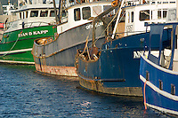 Scenic image of commercial fishing boats in Astoria, Oregon.