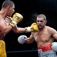 19 November 2009: Fight between Djamel Selini (grey trunks) and Tarik Khaidouri (yellow trunks) during the Grand Tournoi boxing semi finals event at Cirque d'Hiver in Paris, France..