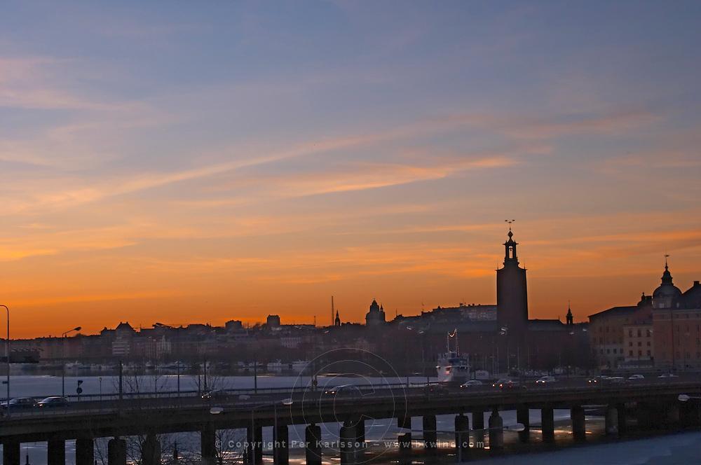 Sunset over Stockholm Slussen with a view over Riddarfjarden the Centralbron bridge and Stadshuset the Town Hall. Stockholm, Sweden, Sverige, Europe