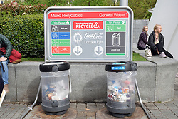 Recycling and waste bins in front of the Coca Cola London Eye, London April 2019 UK