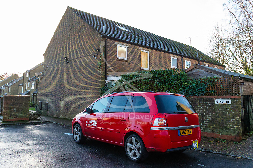 A red private hire minicab allegedly driven by the man arrested is parked outside the house Police are searching in New Ash Green, Kent, home of the former partner of a mother who went missing over two months ago, after his re-arrest on suspicion of murder. New Ash Green, Kent, December 20 2018.