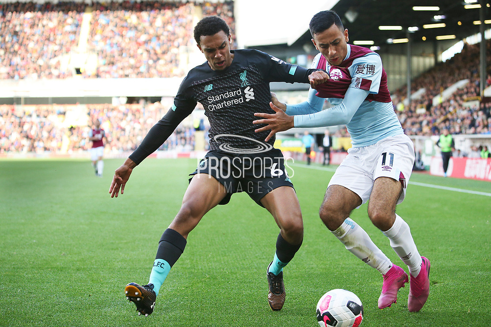Liverpool defender Trent Alexander-Arnold (66) and Burnley midfielder Dwight McNeil (11) tangle during the Premier League match between Burnley and Liverpool at Turf Moor, Burnley, England on 31 August 2019.