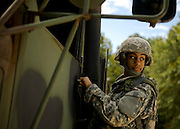 U.S. Army Private Aya Hussain stands next to a military vehicle parked on the bayonet assault course at Fort Jackson, S.C., on October 23, 2008.