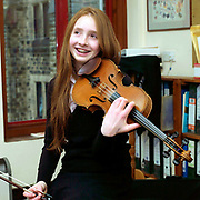 A teenage girl enjoying a violin lesson at Ampleforth College, North Yorkshire, UK. Ampleforth College is a coeducational independent day and boarding school in the village of Ampleforth, North Yorkshire, England. It opened in 1802 as a boys' school, and is run by the Benedictine monks and lay staff of Ampleforth Abbey.
