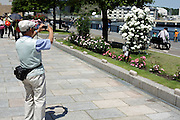 flower garden with senior man making pictures Japan