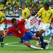 Costa Rica's Wilmer Lopez tackled by Brazil's Gilberto Silva