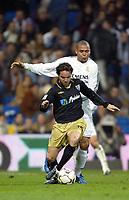 7/2/2004 Madrid, Spain.<br />La Liga (Spanish League) stage 23<br />R.Madrid 2 - Malaga 1<br />R.Madrid's Ronaldo in duel with Malaga's Luque at Santiago Bernabeu's Stadium.<br />© 2004 Alejandro leon Fernandez