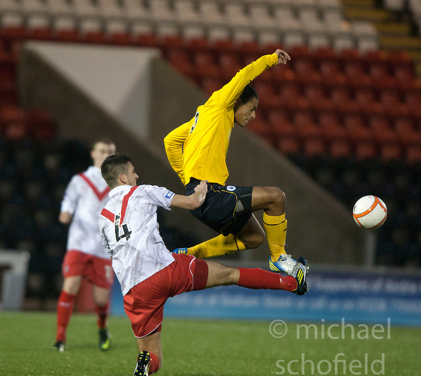 Airdrie United's Gregor Buchanan and Falkirk's Lyle Taylor..half time : Airdrie United 1 v 4 Falkirk, 22/12/2012..©Michael Schofield.