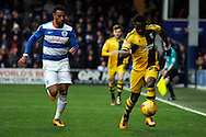Moussa Dembele of Fulham (R) in possession down the nearside of the pitch.  Skybet football league championship match, Queens Park Rangers v Fulham at Loftus Road Stadium in London on Saturday 13th February 2016.<br /> pic by Steffan Bowen, Andrew Orchard sports photography.