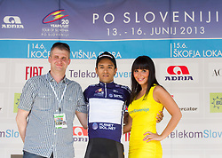 Franci Valjavec and Dalivier Ospina (Kol) Colombia in blue jersey at flower ceremony after the Stage 2 from Kocevje to Visnja Gora (168,5 km) of cycling race 20th Tour de Slovenie 2013,  on June 14, 2013 in Slovenia. (Photo By Vid Ponikvar / Sportida)
