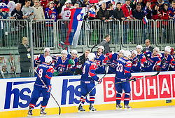 Tomaz Razingar of Slovenia, Andrej Tavzelj of Slovenia and Sabahudin Kovacevic of Slovenia celebrate with other players during ice-hockey match between Great Britain and Slovenia at IIHF World Championship DIV. I Group A Slovenia 2012, on April 15, 2012 in Arena Stozice, Ljubljana, Slovenia. Slovenia defeated Great Britain 3-2. (Photo by Vid Ponikvar / Sportida.com)