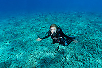 Sylvia Diving on Reef in Seychelles