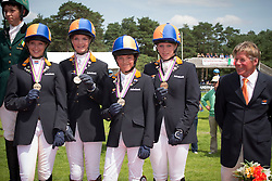 Bronze medal Netherlands<br /> Nina Knape, Joyce Van De Kuylen, Milou De Hoon, <br /> Levi Driessen, chef d'equipe Martin Lips<br /> European Championship Poney - Fontainebleau 2012<br /> © Dirk Caremans