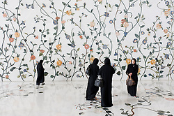 Chinese tourists in black abayas at Sheikh Zayed Mosque in Abu Dhabi , United Arab Emirates, UAE