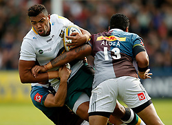 Northampton Saints' Luther Burrell and Harlequins' Karl Dickson and Harlequins' Alofa Alofa during the Aviva Premiership match at Twickenham Stoop, London.