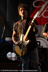 David Graham playing guitar and singing with the Eskimo Brothers Band on Main Street for the 78th annual Sturgis Motorcycle Rally. Sturgis, SD. USA. Saturday August 4, 2018. Photography ©2018 Michael Lichter.