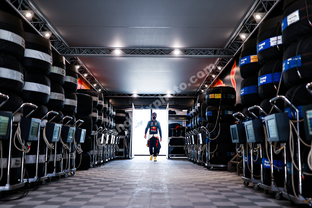 Sergioi Perez (Red Bull-Honda) and tyres in the pits during practice for the 2021 Portuguese Grand Prix in Portimao. Photo: © Copyright: FIA Pool Image via Grand Prix Photo - for Editorial Use Only
