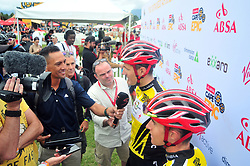 PAARL SOUTH AFRICA - MARCH 23: Yellow Jersey winners Jaroslav Kulhavy and Howard Grotts interviewed after the 70km final day, stage 7 on March 23, 2018 Wellingtion to Paarl, South Africa. Mountain bikers gather from around the world to compete in the 2018 ABSA Cape Epic, racing 8 days and 658km across the Western Cape with an accumulated 13 530m of climbing ascent, often referred to as the 'untamed race' the Cape Epic is said to be the toughest mountain bike event in the world. (Photo by Dino Lloyd)