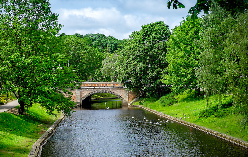 RIGA, LATVIA - CIRCA JUNE 2014: View of the city canal in Bastion Hill Park in Riga