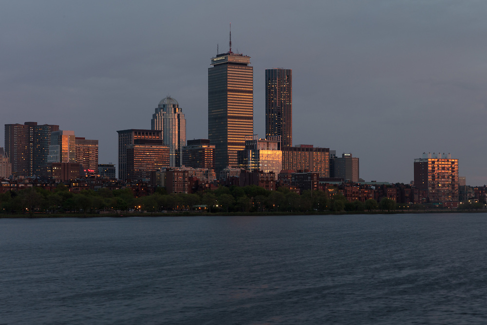 The springtime sunset illuminating the buildings of Boston's Back Bay skyline.