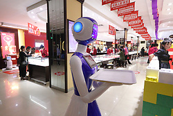 April 18, 2018 - Binzhou, Binzhou, China - Binzhou, CHINA-18th April 2018: A robot provides shopping assistance for customers at a gold shop in Binzhou, east China's Shandong Province. (Credit Image: © SIPA Asia via ZUMA Wire)