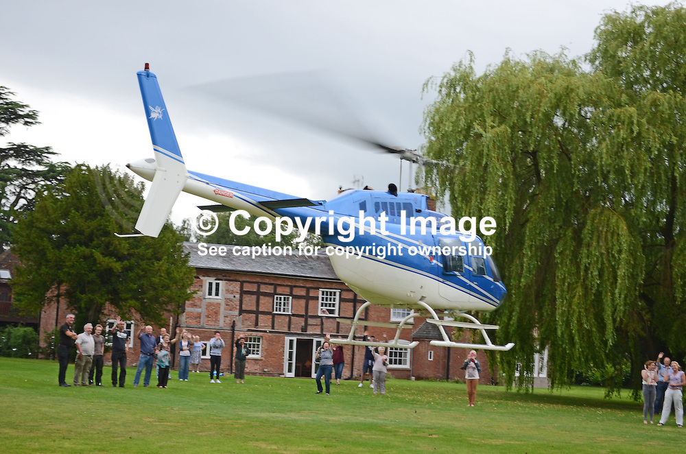 Private helicopter, G-RUCK, takes off from the grounds of Elm Lodge, Fishmore, Ludlow, Shropshire, UK, to bring four secondary school pupils to their school's formal end of term dance, also referred to as a prom. 201407043215<br /> <br /> Copyright Image from Victor Patterson, Belfast, UK<br /> <br /> t: +44 28 9066 1296 (from Rep of Ireland 048 9066 1296)<br /> m: +44 7802 353836<br /> e: victorpattersonbelfast@gmail.com<br /> <br /> www.images4media.com<br /> <br /> Please see my full Terms and Conditions of Use at https://www.images4media.com/p/terms-conditions - it is IMPORTANT that you familiarise yourself with them.<br /> <br /> Images used online incur an additional cost. This cost should be agreed in writing in advance. Online images must be visibly watermarked i.e. © Victor Patterson or that of the named photographer within the body of the image. The original metadata must not be deleted from images used online.<br /> <br /> This image is only available for the use of the download recipient i.e. television station, newspaper, magazine, book publisher, etc, and must not be passed on to a third party. It is also downloaded on condition that each and every usage is notified within 7 days to victorpattersonbelfast@gmail.com.<br /> <br /> The right of Victor Patterson (or the named photographer) to be identified as the author is asserted in accordance with The Copyright Designs And Patents Act (1988). All moral rights are asserted.