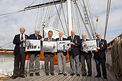 © Licensed to London News Pictures. 18/09/2013. London, UK. Sid Hunt, 89 (L), Leslie Taylor, 89 (2L), Don Staddon, 88 (3L), Captain Gwilym Williams, 98 (C), Fred Honisett, 88 (3R), Derek Ings, 88 (2R) and Stanley Mayes, 88 (R), all World War Two veterans of the Merchant Navy, hold new Royal Mail stamps showing scenes from World War Two Atlantic and Arctic convoys during their launch at the Cutty Sark in Greenwich, London, today (18/09/2013). The stamps, issued along with others depicting famous merchant ships including the Cutty Sark, are available from the 19th of September 2013. Photo credit: Matt Cetti-Roberts/LNP