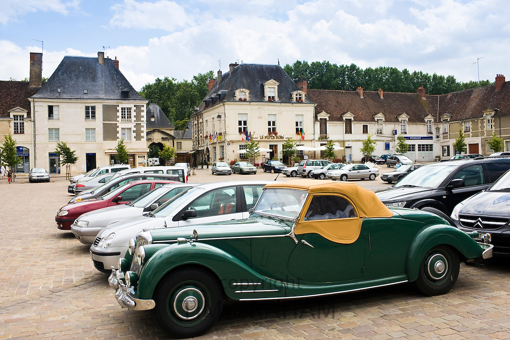 Traditional Riley classic convertible car in Place du Marche town square, Richelieu, Loire Valley, Indre et Loire, France