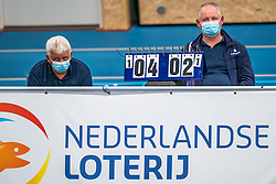 Due to the covid-19 measures, the floor crew wore mouth masks during the supercup semifinal between Draisma Dynamo – Active Living Orion on October, 03 2020 in Van der Knaaphal, Ede