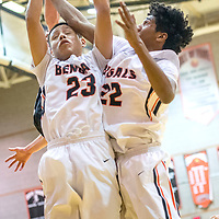 Gallup Bengals Tyrell Begay (23) and  Zakarri Fields (22) vie for a rebound after a Sandia Prep Sundevil missed shot during the Bengal Boys Basketball Invitational Tournament at Gallup High School Friday.