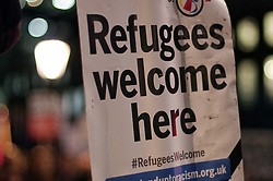 © Licensed to London News Pictures. 22/02/2016. London, UK. A 'Refugees Welcome' demonstration on Whitehall, opposite Downing Street this evening (22/02/2016). A large part of the Calais refugee camp, referred to as The Jungle, has been give an eviction notice by French courts.  Photo credit: Denis McWilliams/LNP