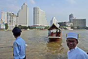 View over Chao Phraya River towards Oriental Hotel (l.) and Shangri-La (r.) from terrace of Peninsula Hotel. The Peninsula shuttle ferry is about to arrive.