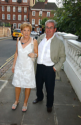 Left, ANNE ROBINSON and her husband JOHN PENROSE at Sir David & Lady Carina Frost's annual summer party held in Carlyle Square, Chelsea, London on 5th July 2006.<br /><br />NON EXCLUSIVE - WORLD RIGHTS