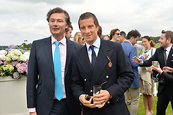 Left to right, LAURENT FENIOU and BEAR GRYLLS at the Cartier Queen's Cup Polo final at Guard's Polo Club, Smiths Lawn, Windsor Great Park, Egham, Surrey on 14th June 2015