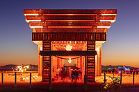 The Temple of Direction<br /> by: Geordie Van Der Bosch<br /> from: San Francisco, CA<br /> year: 2019<br /> <br /> The Temple of Direction is organized linearly. It recreates a restricted passage which expands in the center into a large hall. This is a response to the openness of the playa; it creates a space traveled end to end; versus wandering an open plan; this temple provides direction and focus. Linearity also reflects the passage of life; all lives have a beginning, a middle and an end which metaphorically is included in this temple's form. Following this metaphor a variety of spaces are created; narrow spaces and wide spaces, dark spaces and bright spaces. Tunnels create intimate experiences with shade.. A large central hall expands in width and height providing a bright area suitable for gatherings.<br /> <br /> URL: https://www.templeofdirection.org<br /> Contact: templeofdirection@gmail.com<br /> <br /> https://burningman.org/event/brc/2019-art-installations/?yyyy=&artType=H#a2I0V00000167U9UAI