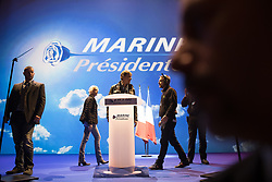 © Licensed to London News Pictures . 17/04/2017 . Paris , France . Security surround the podium ahead of the le Pen's speech . Marine le Pen's French far-right party , Front National , hold a meeting at the Zénith Paris arena , ahead of elections in France . Photo credit: Joel Goodman/LNP