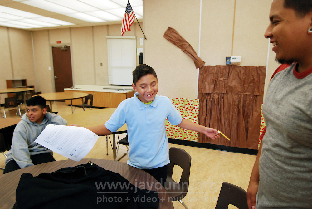 Sherwood Elementary School student Yacer PIcazo finds fun in doing his homework after school, as tutor Stephen Corona looks on. Tutoring for area children in many subjects is also available at the nearby Los Padres Learning Center and the Cesar Chavez Library.
