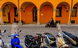 A man on a moped speeds along a street in Bologna, Italy<br /> <br /> (c) Andrew Wilson | Edinburgh Elite media