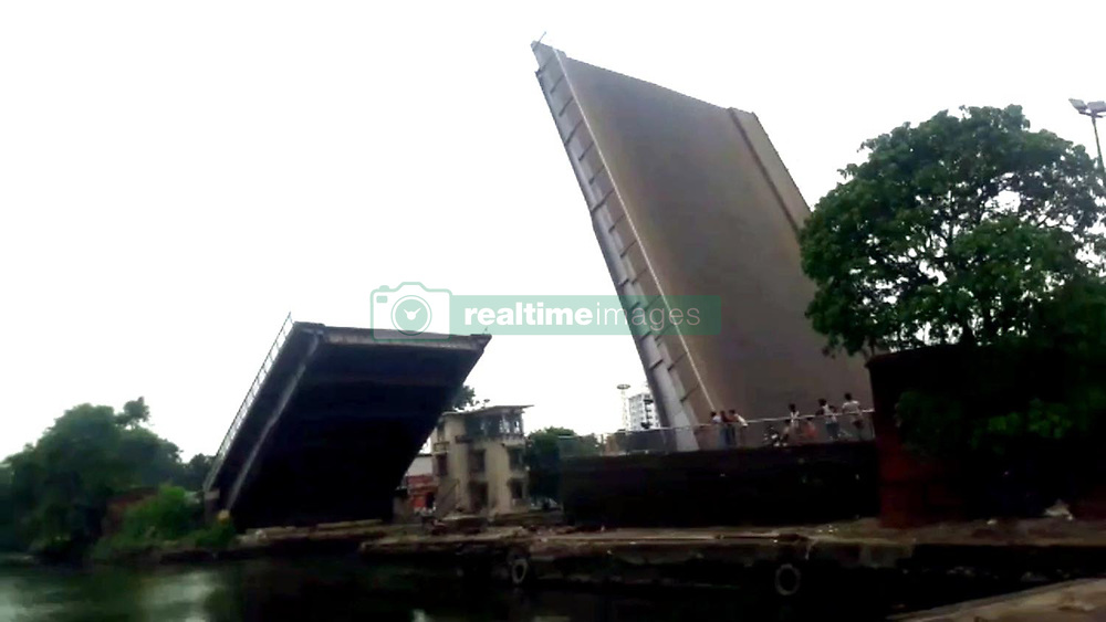 August 7, 2017 - Kolkata, West Bengal, India - Kolkata Dock System's 118-year old Swing Bridge,The bridge, built by London-based West Wood Baillie & Co, as early as 1890, connects the turning basin with main Kidderpore Dock No 1. The original design allowed for the railway track to be held on the middle of the bridge, but this alignment was subsequently changed to avoid sharper curve at either end of the track. The original bridge carried a clear roadway of 23.33 ft for both slow and fast moving traffic. But not anymore. On re-commissioning of the bridge after repair work, undertaken by Jessop & Co , no heavy vehicular traffic will be allowed. The repair cost is estimated at Rs. 1.5 crore shared equally between Kolkata Port Trust, South Eastern Railway and West Bengal Government. (Credit Image: © Debajyoti Chakraborty/NurPhoto via ZUMA Press)